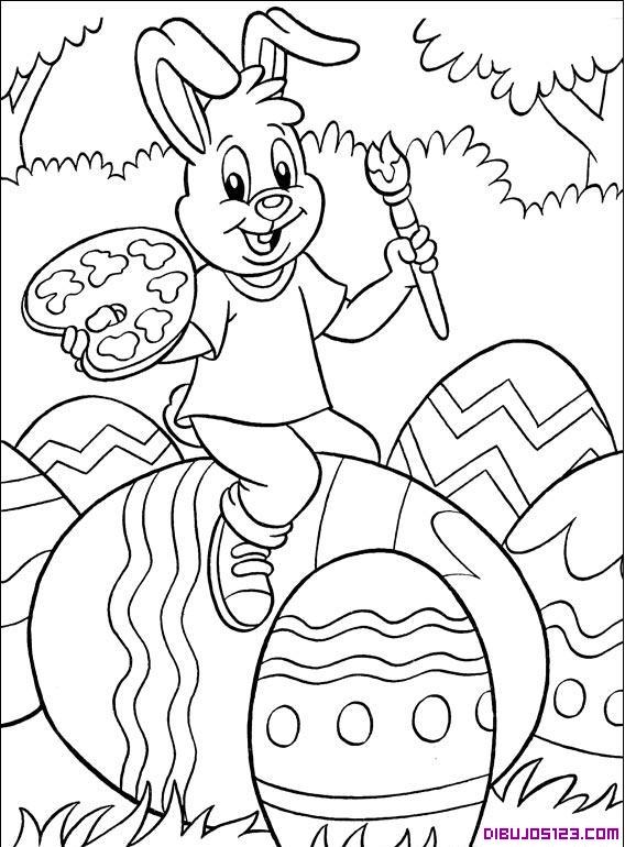 Simpatico conejo pintando huevos de Pascua