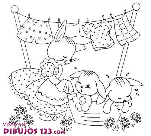 Mamá conejo baña a sus hijos
