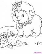 Una oveja muy simpatica buscando flores